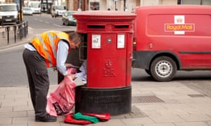 Postman emptying a postbox