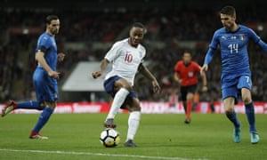 England's midfielder Raheem Sterling (L) is chased by Italy's midfielder Jorginho