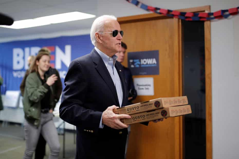 What's Joe Bitin'? The former vice president with a stack of pizzas.
