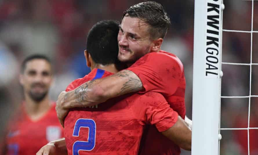 Jordan Morris (right) is hugged by teammate Nick Lima after his goal
