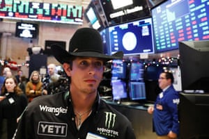 Professional bull rider J. B. Mauney walks on the floor of the New York Stock Exchange shortly after the opening bell in New York, U.S., January 5, 2018. REUTERS/Lucas Jackson
