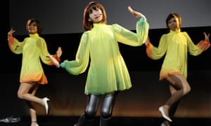 AIST's robot sings and dances with performers at the Digital Contents Expo in Tokyo in 2010