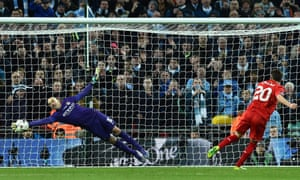 Manchester CIty goalkeeper Willy Caballero makes one of three outstanding penalty saves to help his side to the Capital One Cup
