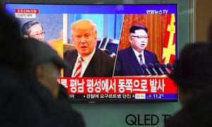 People watch the news on a television screen in Seoul on Wednesday.