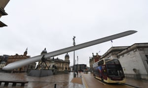 A bus drives under the artwork Blade by Nayan Kulkarni in Queen Victoria Square, Hull