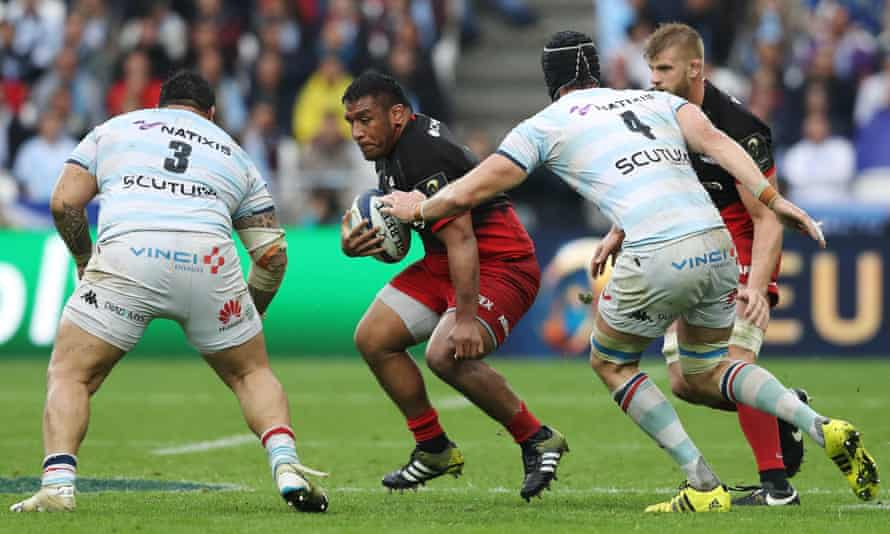 Mako Vunipola of Saracens is challenged by Ben Tameifuna and Luke Charteris of Racing 92 during the European Rugby Champions Cup final in May 2016.