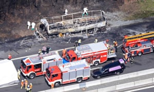 Emergency vehicles at the scene of bus blaze in Bavaria, which killed 18.