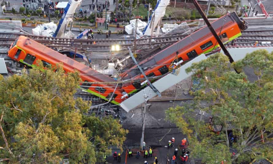Two subway carriages hang from the collapsed overpass in Mexico City. At least 24 people have died in the disaster.
