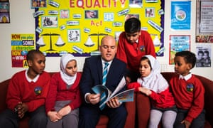 Assistant headteacher Andrew Moffat with pupils at Parkfield community school.