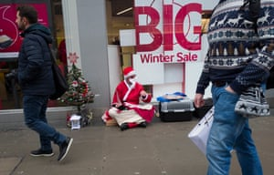 A rough sleeper dressed as Santa Claus. One in every 200 people in the UK are homeless, according to the charity Shelter