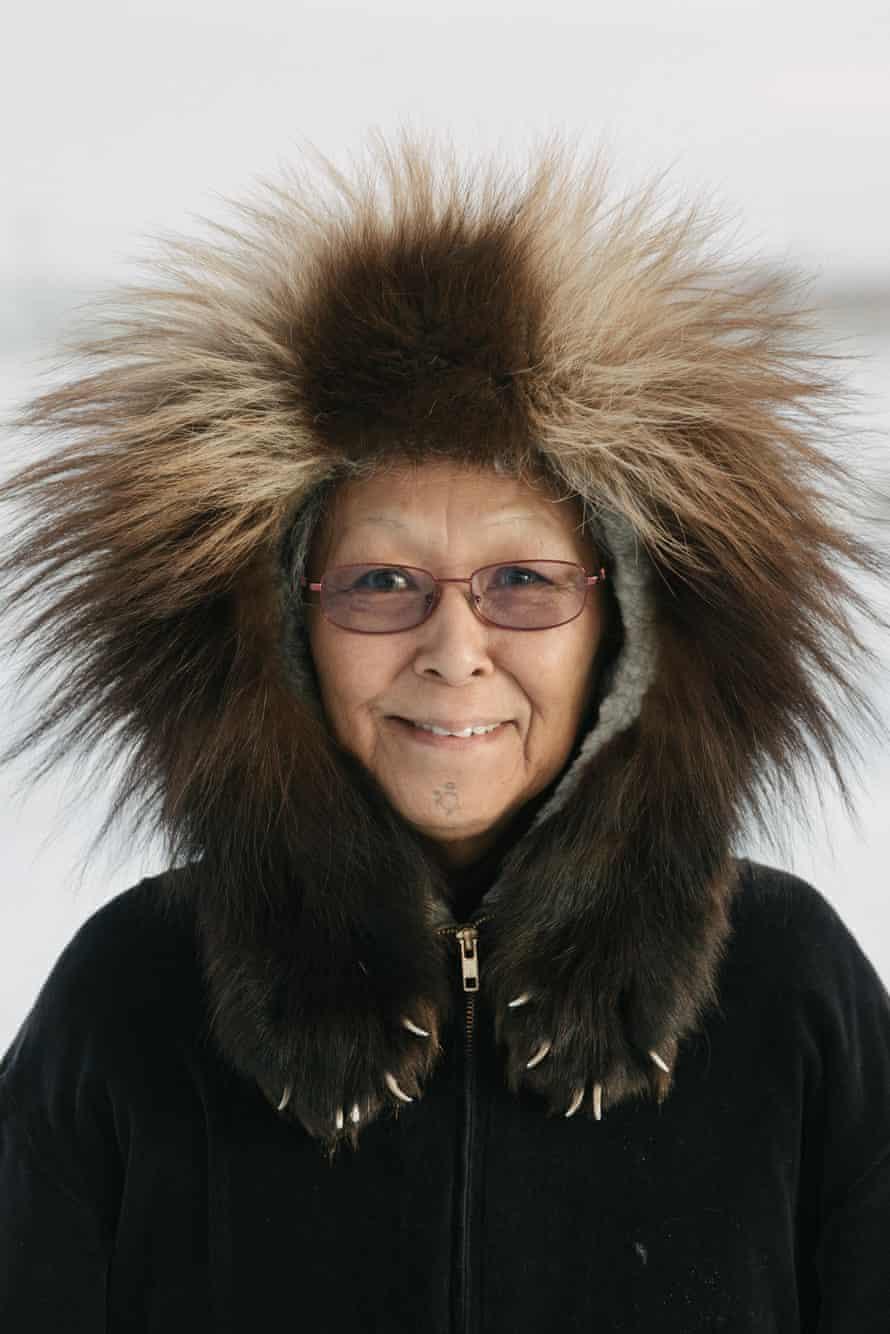Fannie Akpik, Iñupiaq educator and survivor of Indian boarding schools, wears her traditional wolverine ruff parka, in Utqiagviq, Alaska.