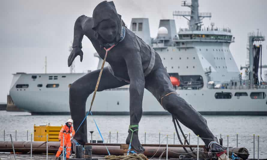 The Messenger sculpture arrives in Plymouth by barge to be installed outside the city's Theatre Royal