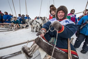 Participants from Nenets Autonomous Okrug ride sleds during a reindeer race on the Reindeer Herders Day