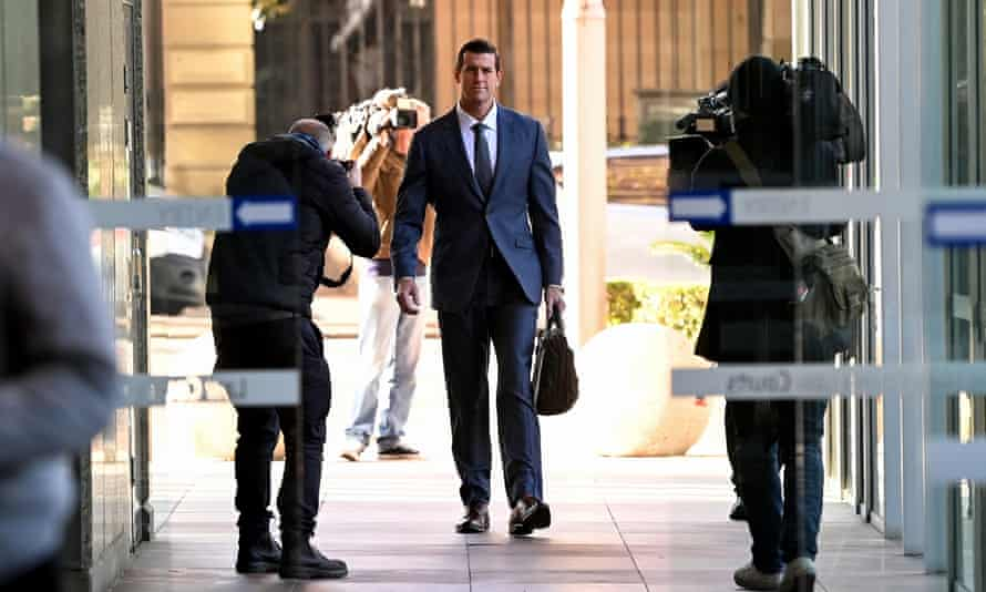 Ben Roberts Smith (centre) arrives at the federal court in Sydney on Friday.