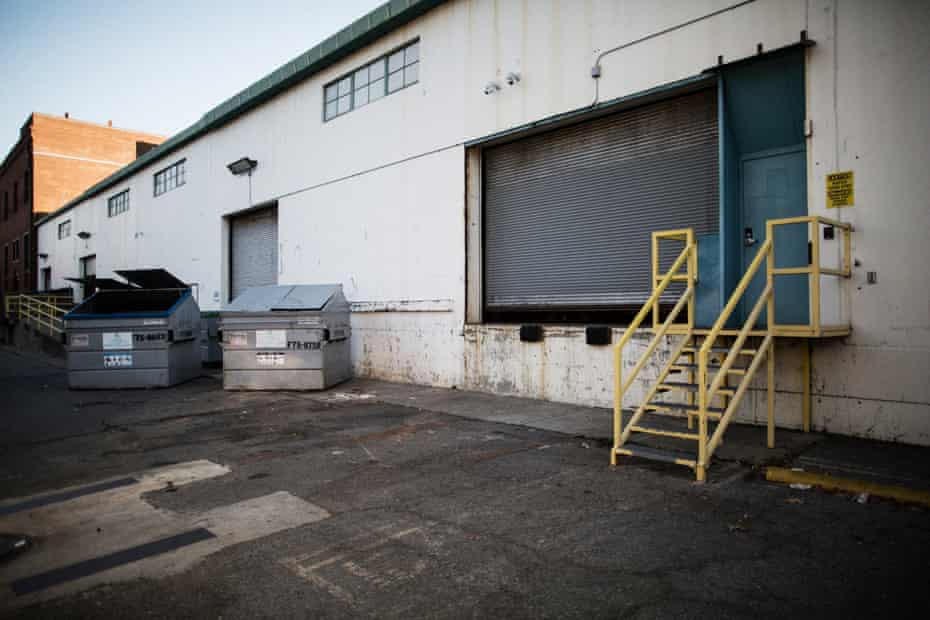 The dumpsters outside of an Amazon warehouse, where the homeless man's body was found.