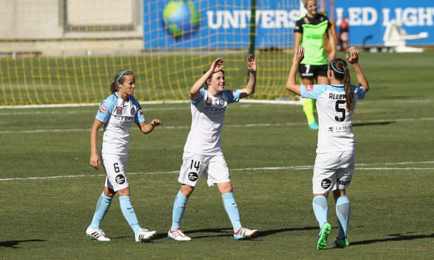 Melbourne City players celebrate a goal against Canberra United.