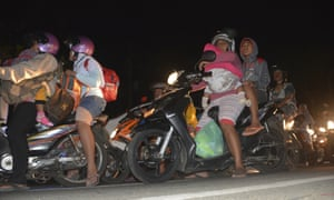 People try to reach higher ground amid fears of tsunami, following an earthquake on the island of Java.