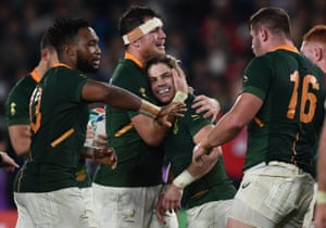 South Africa's players celebrate winning the match.