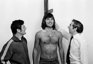 Manchester United coaches Malcolm Musgrove and Laurie Brown, right, during Best's pre-season physical examination at Old Trafford in July 1971