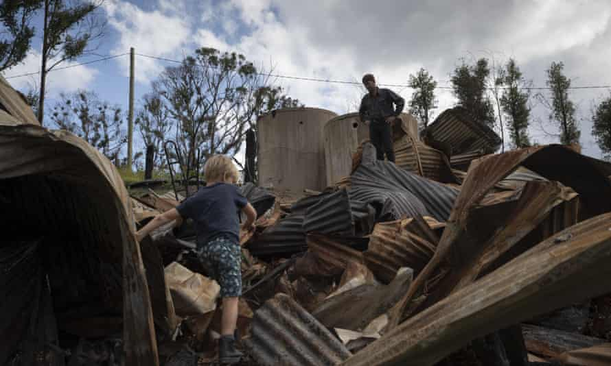 Bushfire survivor Ian Livingston and his son Sydney, 6, among the ruins of their family home, lost to the New Year's Day bushfires in Cobargo.