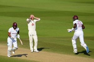 Stokes reacts as Campbell and Holder take a run.