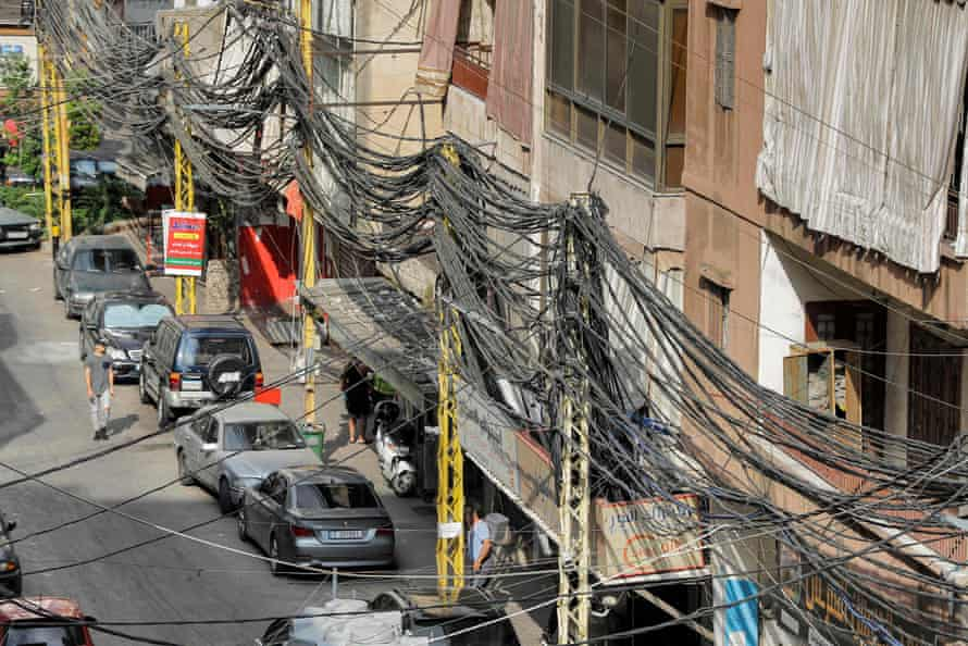 A tangle of raised electricity lines along a street in a suburb of Beirut