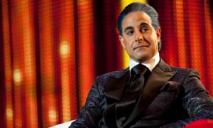 A satire on of the cut-throat format of reality TV – prseenter … Stanley Tucci as Caesar Flickerman.