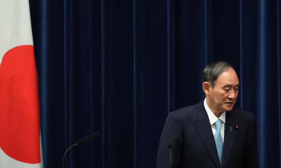 Japan's prime minister Yoshihide Suga, who is due to step down this month, leaves after a press conference in Tokyo, 9 September, 2021.