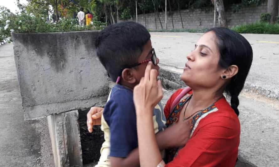 Vidya with Vineeth, 10, who has the incurable disease mucopolysaccharidosis II. India has no budget for such rare diseases.