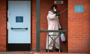 A worker for Leicester city council disinfecting public toilets in the city this morning.