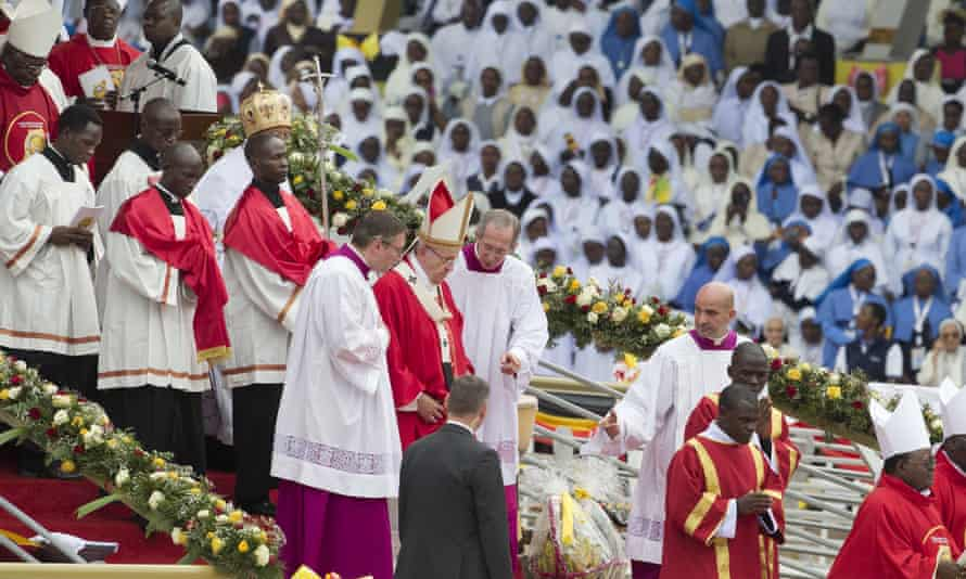 Pope Francis in a procession with other clergy after leading a holy mass in the Namugongo area of Kampala.