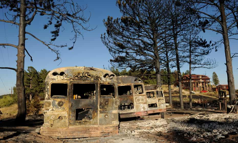 Burned buses at the Colorado Mountain Ranch in the historic town of Gold Hill in the Fourmile Canyon fire area in Boulder, Colorado, attest to the effects of a devastating wildfire,