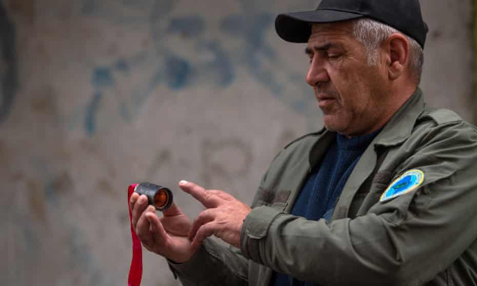 A man holds a unit of a cluster bomb in Stepanakert, the capital of Nagorno-Karabakh.