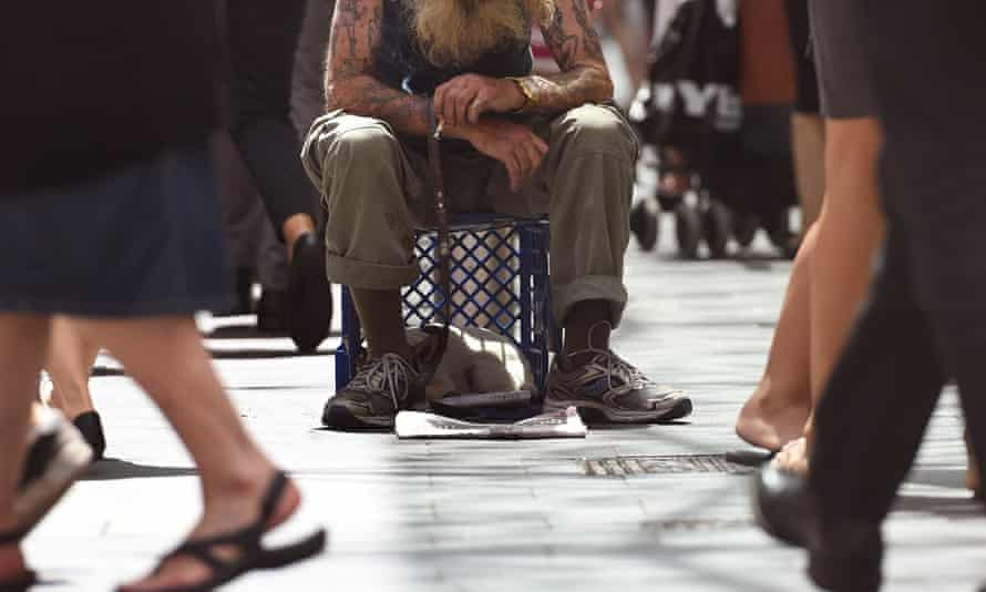 A man begs for money in Sydney's central business district