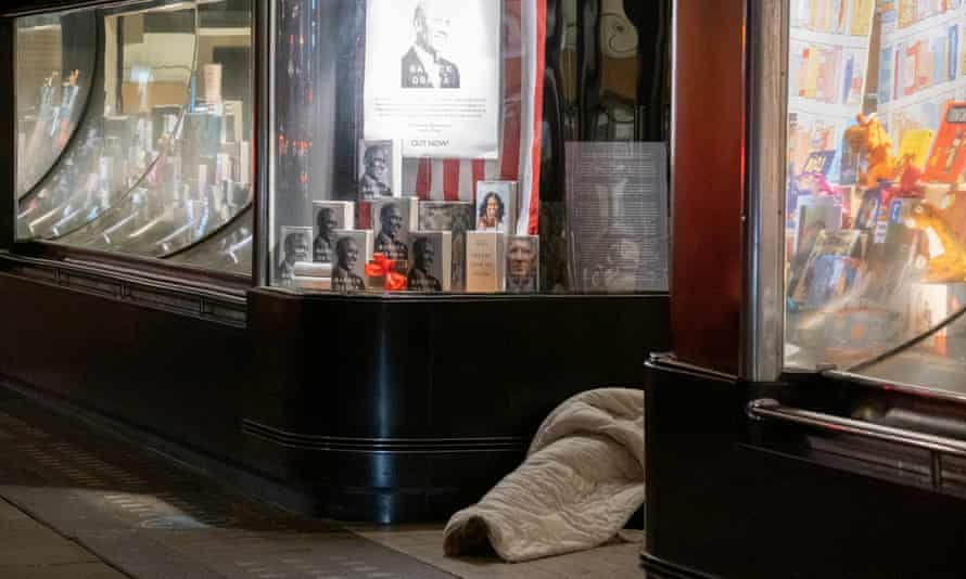 A homeless person lies in a doorway in Piccadilly, London