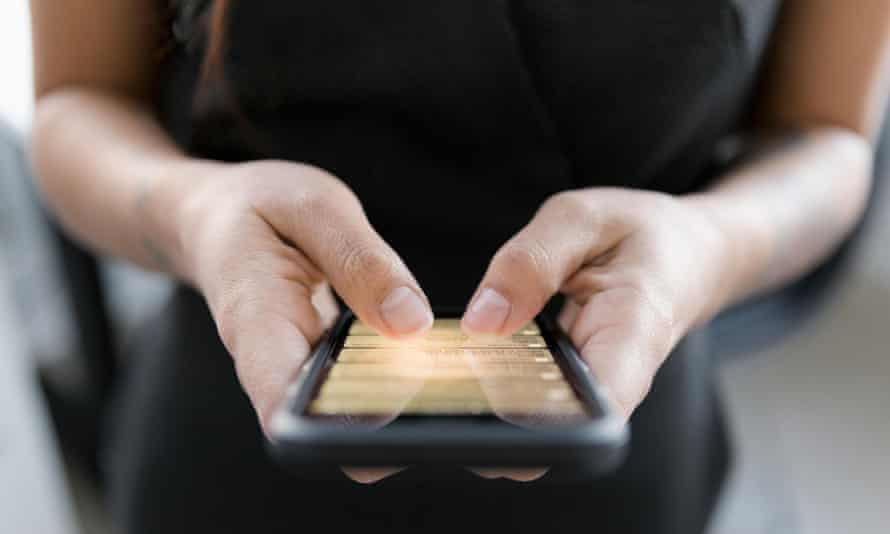 File photo of woman using smartphone