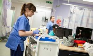 A nurse prepares medication in A&E .
