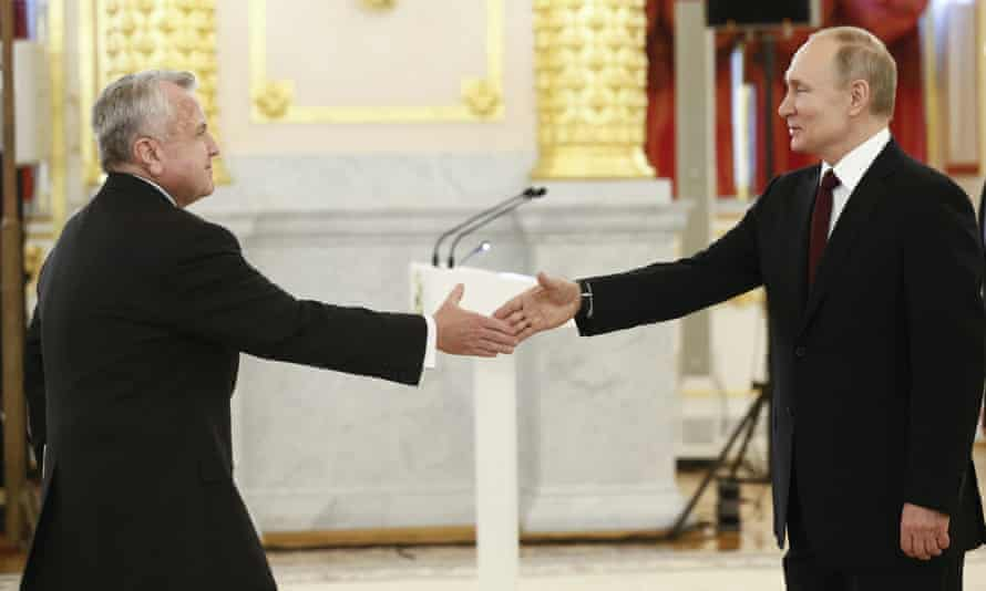 John Sullivan (left) shakes hands with the Russian president, Vladimir Putin, in Moscow in January 2020