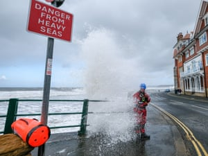 A wave breaks over the seafront at Sandsend and on to the route of the Tour de Yorkshire
