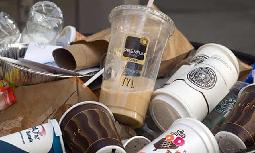Overflowing bin filled with coffee cups