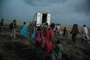 On the road to Ethiopia, people scramble to board a truck