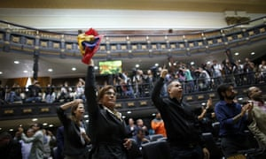 Anti-government lawmakers shout 'fraud' during a session of Venezuela's National Assembly in Caracas Wednesday.