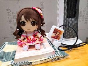 A doll of anime character Uzuki Shimamura, who is voiced by Tiger Ye's idol Ayaka Ohashi