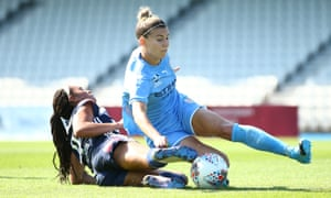 Steph Catley (right) in action for Melbourne City against Melbourne Victory in February.