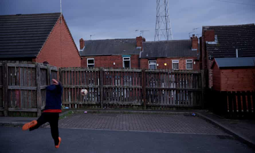 A boy playing football in Rotherham
