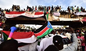 Demonstrators gather near the headquarters of the military in Khartoum