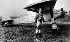Charles Lindbergh, without helmet, poses with his famous plane The Spirit of St Louis in 1927.