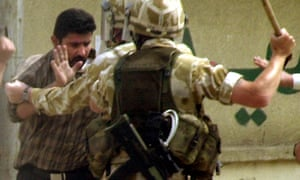 British soldiers detain an Iraqi man in Basra in 2004.