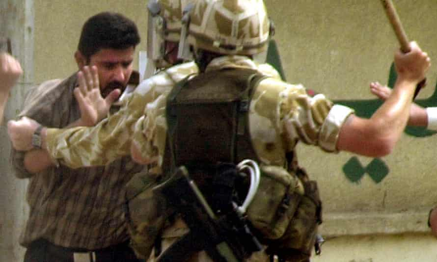 British soldiers detain an Iraqi man in Basra in 2004.