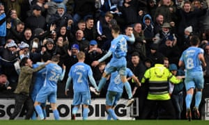 Coventry City players and fans celebrate Maxime Biamou's winner against MK Dons